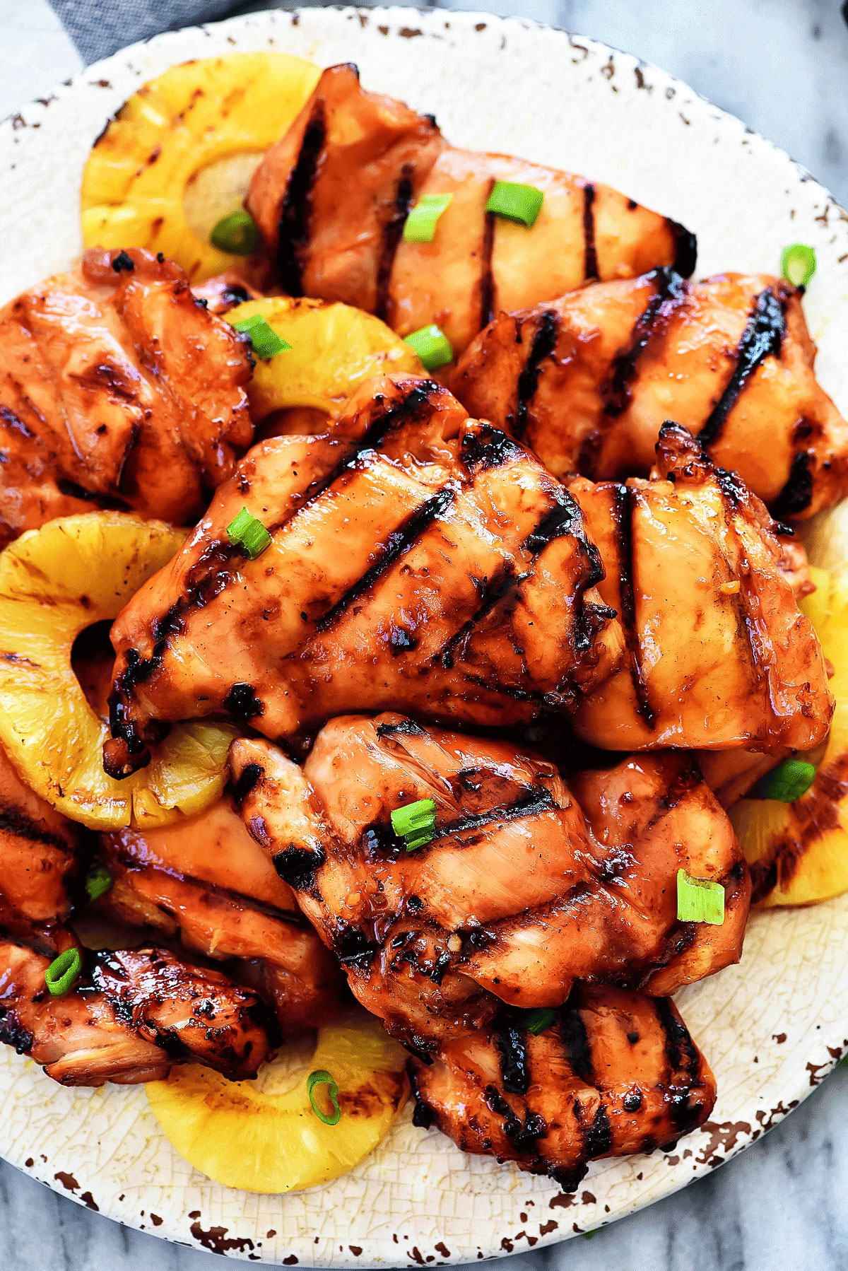 Grilled Huli Huli Chicken is delicious grilled chicken bursting with pineapple and Hawaiian flavor. Life-in-the-Lofthouse.com