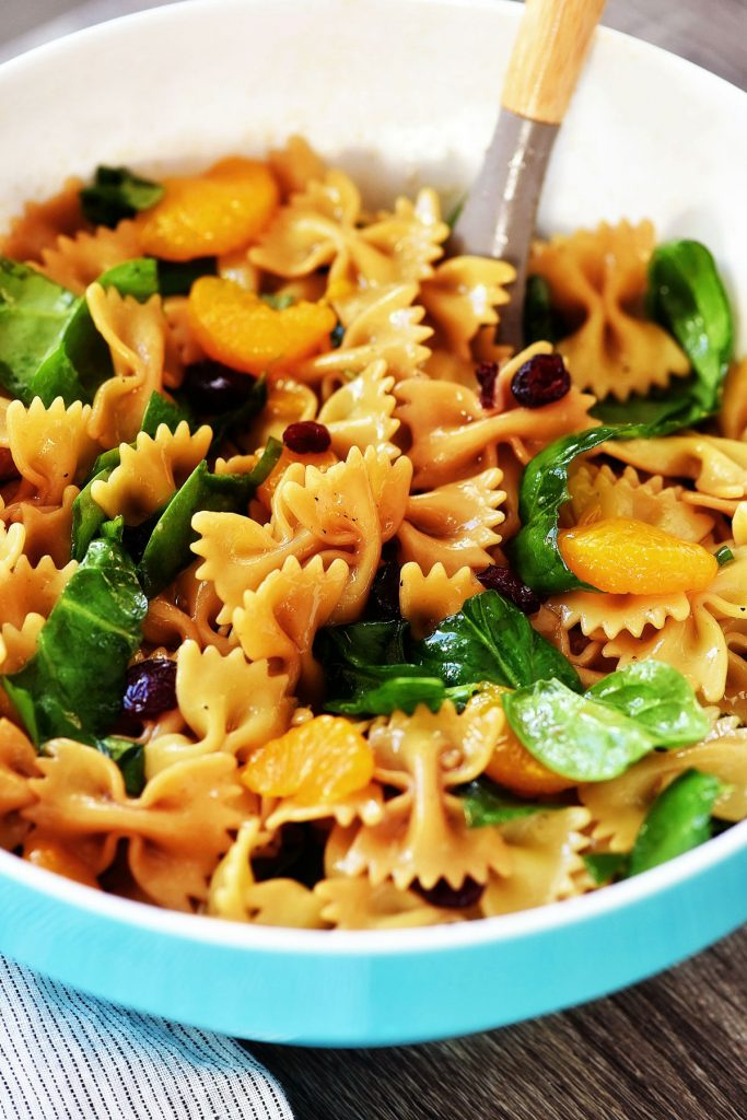 Mandarin Orange and Spinach Pasta Salad is bow tie pasta noodles coated in teriyaki sauce with oranges, spinach and dried cranberries. Life-in-the-Lofthouse.com