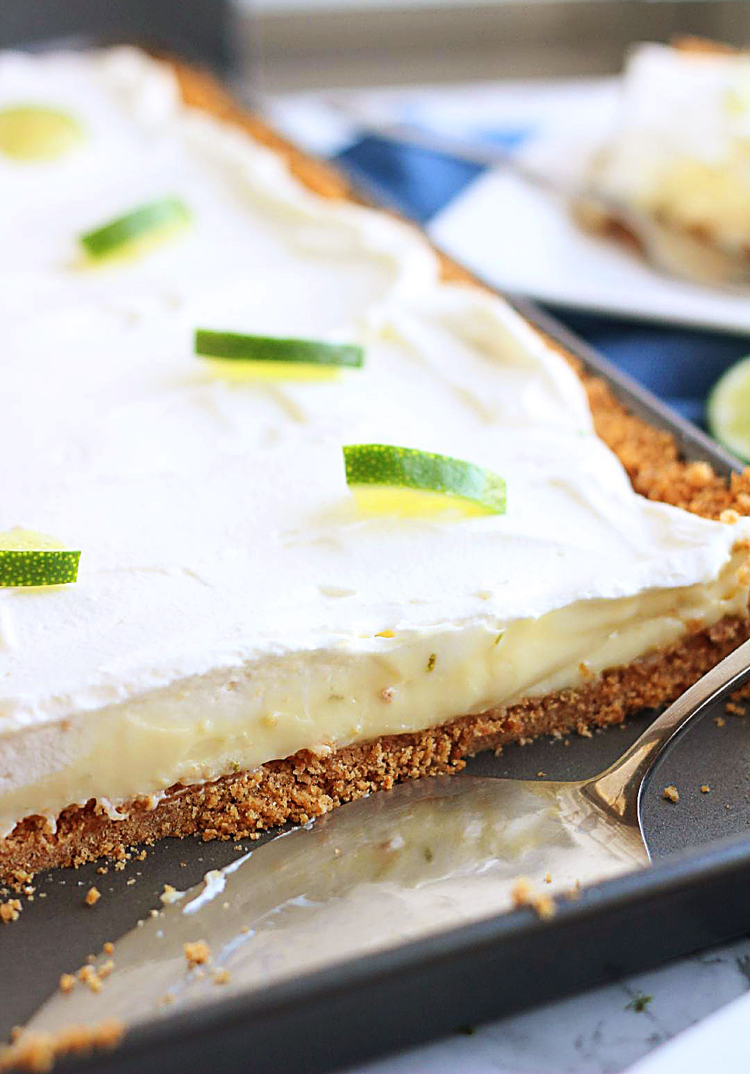 Key Lime Slab Pie is a creamy, refreshing pie full of lime flavor with a graham cracker crust. Life-in-the-Lofthouse.com