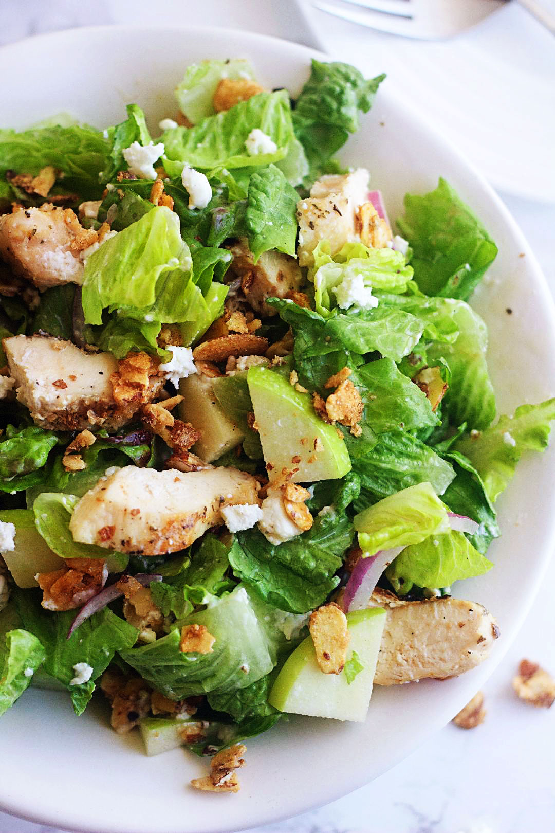 Chicken, Apple & Goat Cheese Salad is full of candied nuts, apples, goat cheese & chicken and tossed in a light champagne vinaigrette. Life-in-the-Lofthouse.com