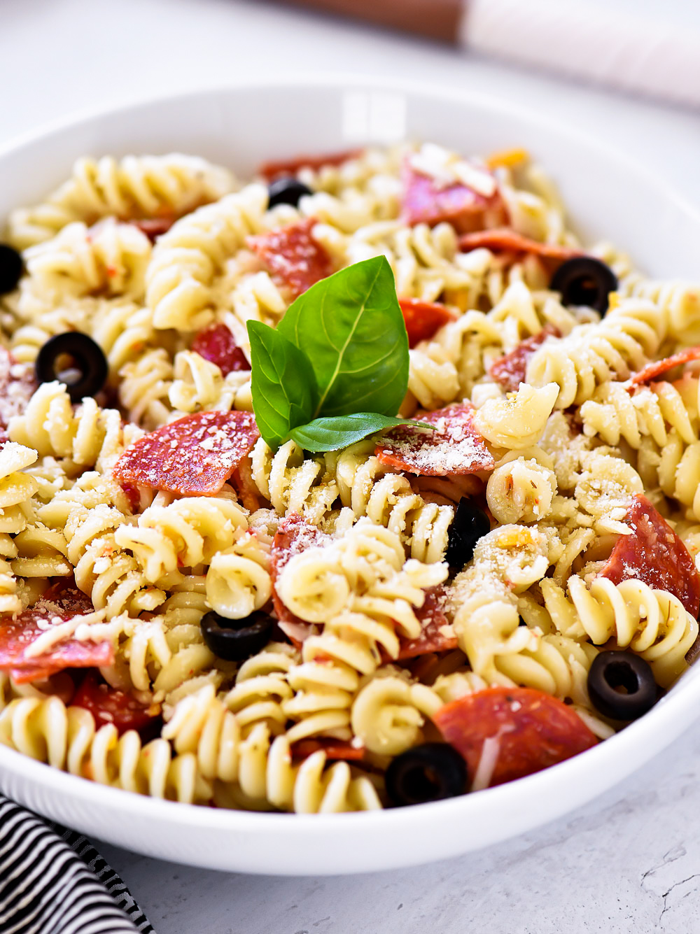 Pepperoni Pizza Pasta Salad is filled with noodles, pepperoni, cheese, Italian dressing and black olives. Life-in-the-Lofthouse.com