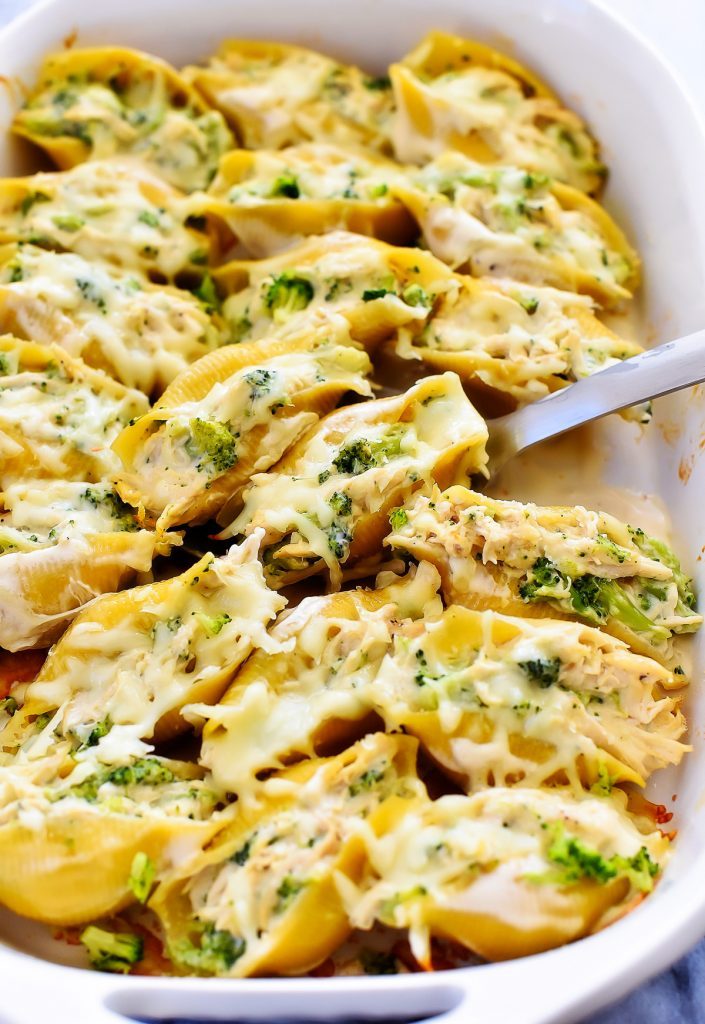 Chicken & Broccoli Alfredo Stuffed Shells is shredded chicken and broccoli combined with Alfredo sauce and stuffed inside jumbo pasta shells. Life-in-the-Lofthouse.com