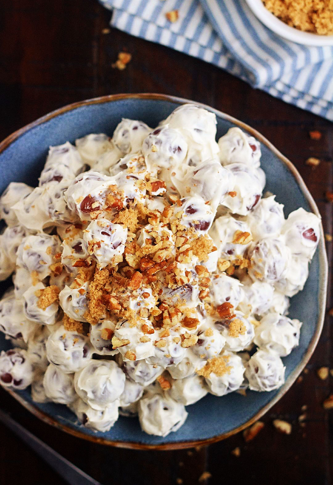 Grape Salad is full of fresh, sweet grapes, tossed in a sweet cream cheese dressing, then sprinkled with brown sugar and pecans. Life-in-the-Lofthouse.com