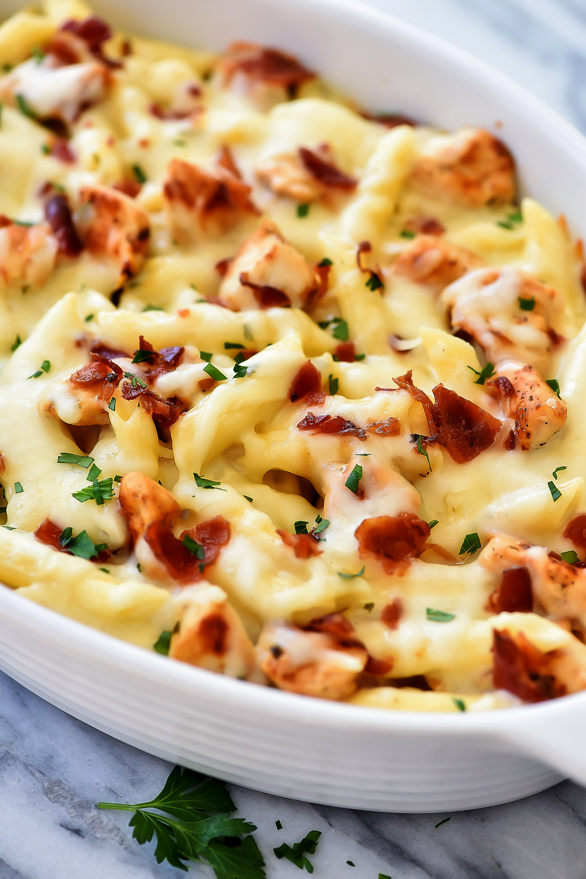 Chicken Ranch Pasta Bake has chicken, bacon and mozzarella cheese and is full of creamy ranch flavor. Life-in-the-Lofthouse.com