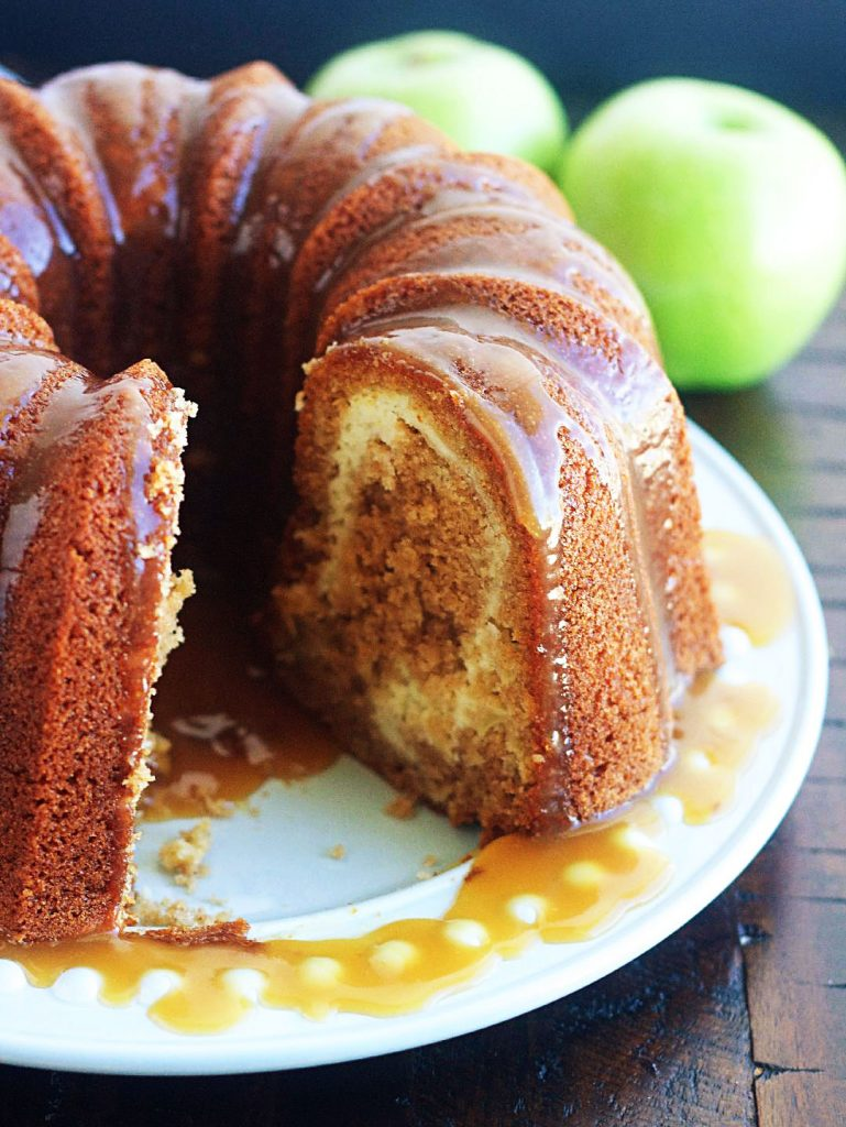 Apple Bundt cake with Cream Cheese Swirl is a moist, delicious apple bundt cake filled with cream cheese and topped with a caramel sauce. Life-in-the-Lofthouse.com