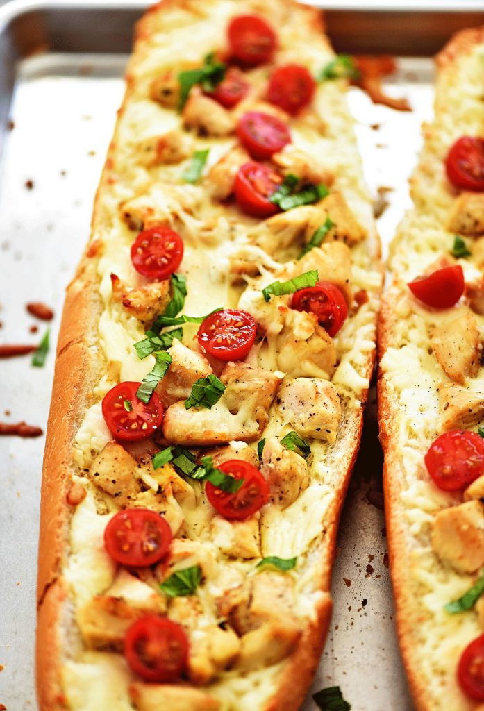 Chicken Caprese Garlic Bread is garlic bread topped with seasoned grilled chicken, lots of Mozzarella cheese, tomato and basil. Life-in-the-Lofthouse.com