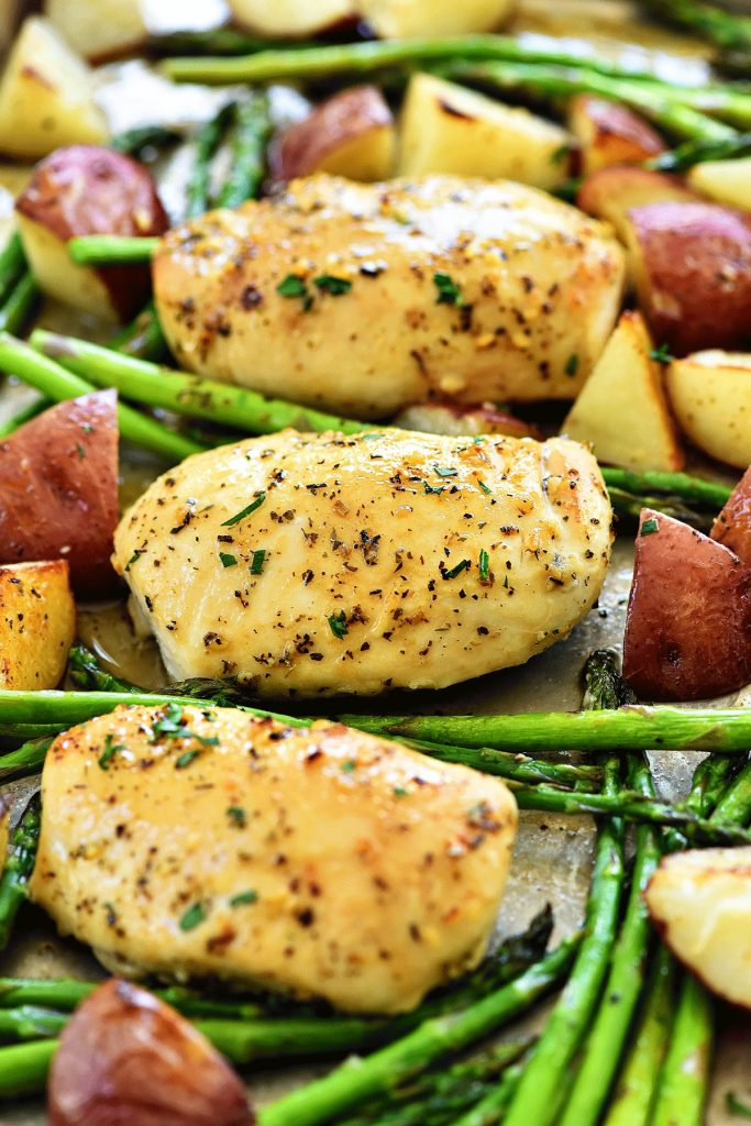 This Honey Garlic Chicken and Veggies recipe has tender, flavor-packed chicken, potatoes and asparagus all made in one pan. Life-in-the-Lofthouse.com