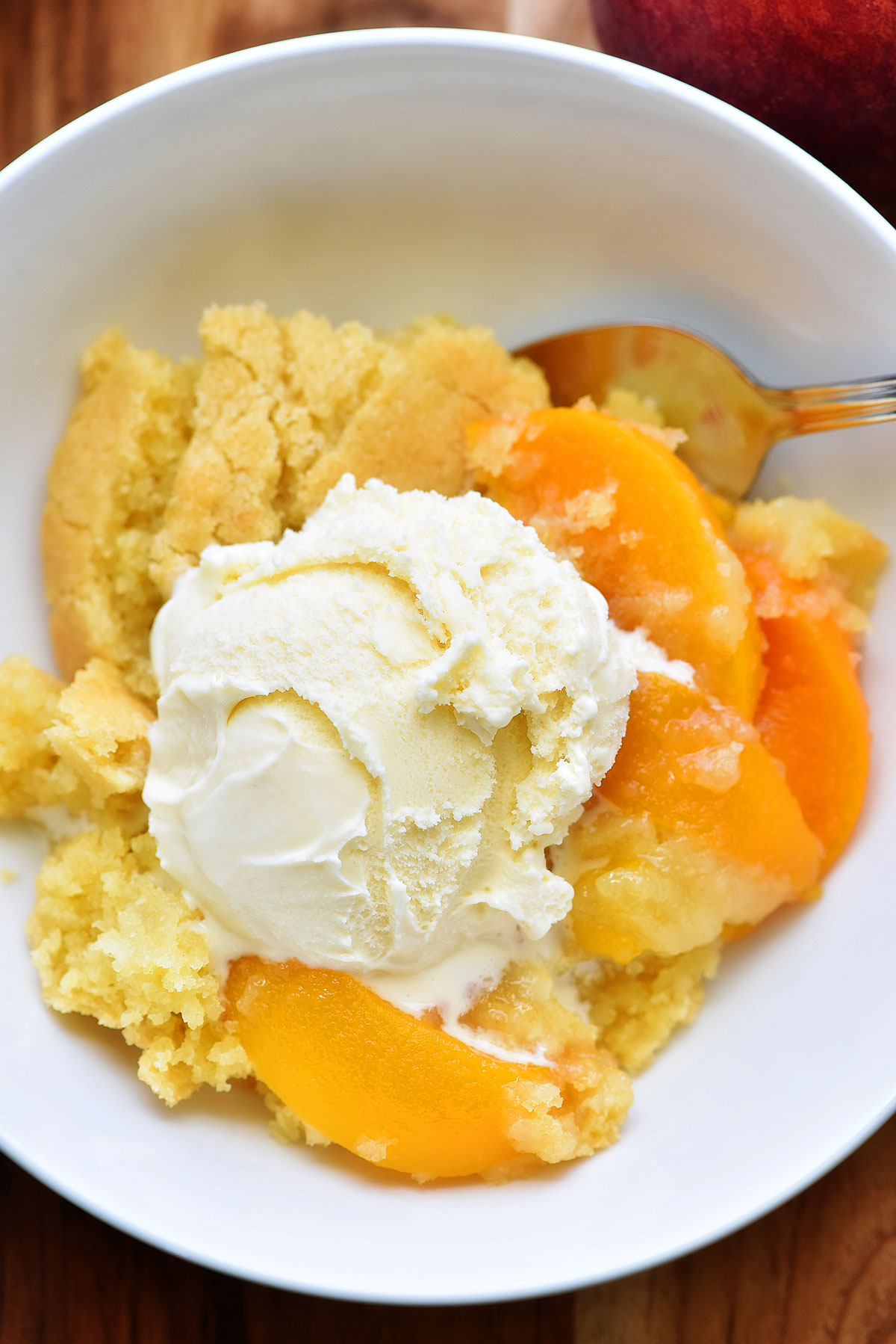 The Best Peach Cobbler is a delicious cake-like dessert made with sliced peaches and served warm with vanilla ice-cream. Life-in-the-Lofthouse.com