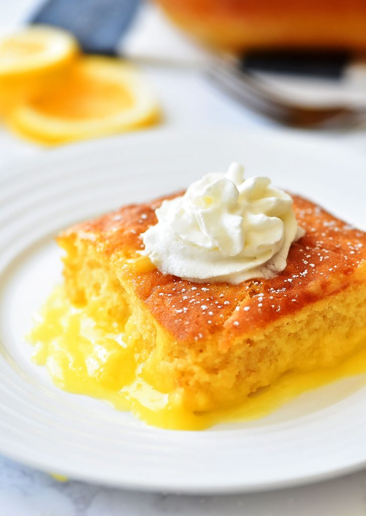 Lemon Pudding Cake is a moist, light and fluffy yellow cake that bakes over the top of creamy lemon pudding. Life-in-the-Lofthouse.com