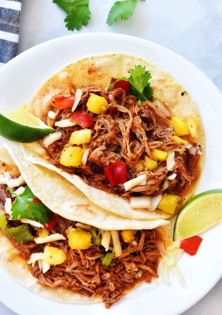 Sweet Pork tacos are tacos filled with tender sweet pork, Monterey jack cheese and pineapple salsa. Life-in-the-Lofthouse.com