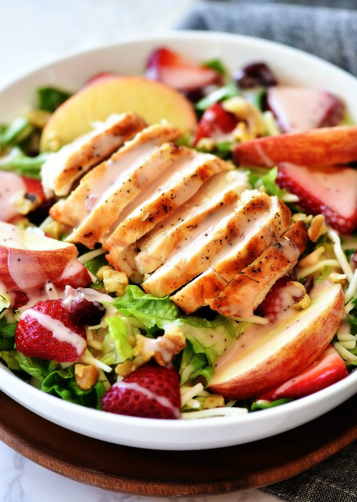 The Best Strawberry Chicken Salad is a refreshing salad full of grilled chicken, strawberries, sliced apples, mozzarella cheese and more. Life-in-the-Lofthouse.com