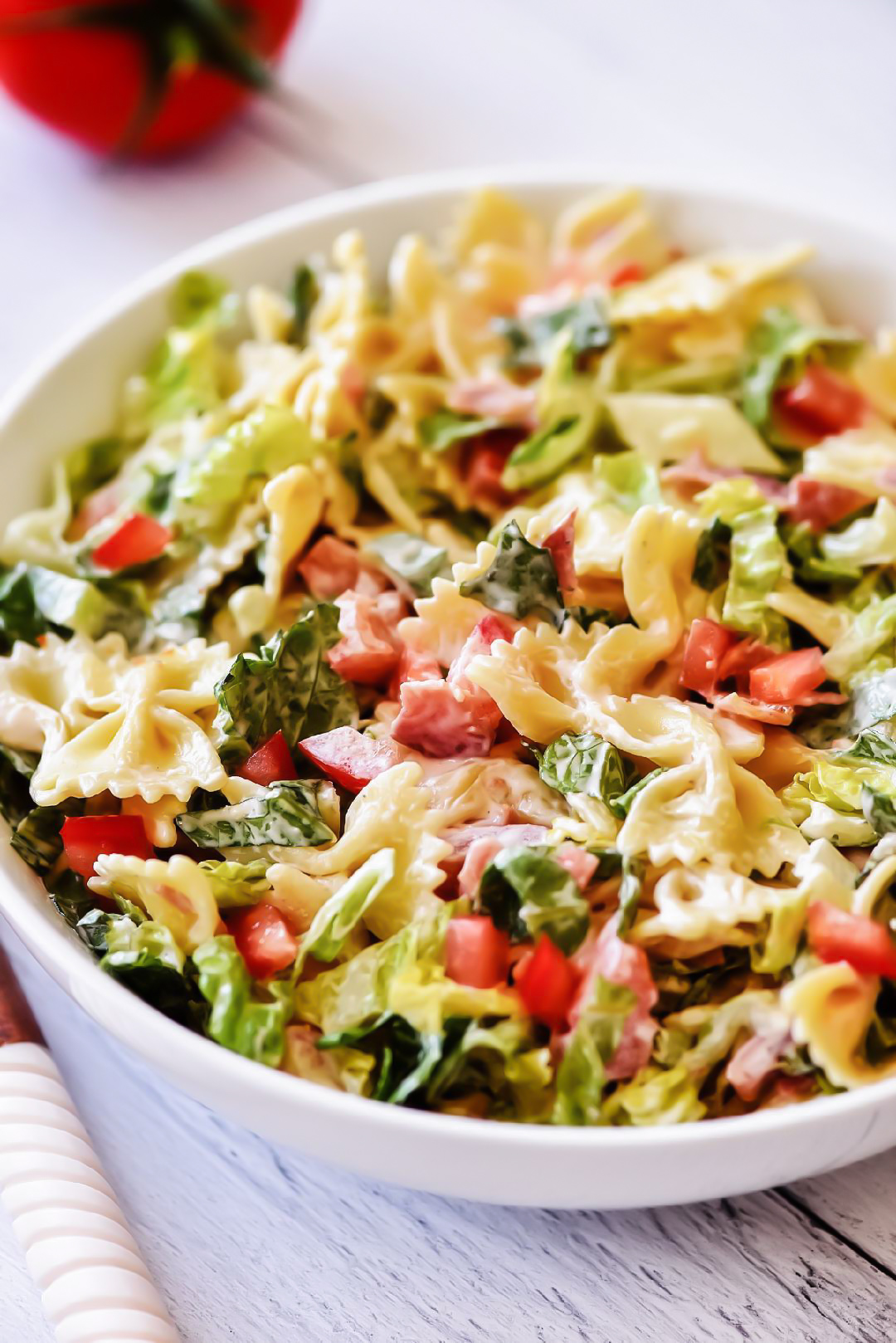 BLT Pasta Salad is filled with bacon, lettuce and tomato. It also includes pasta all covered in a creamy ranch dressing. Life-in-the-Lofthouse.com