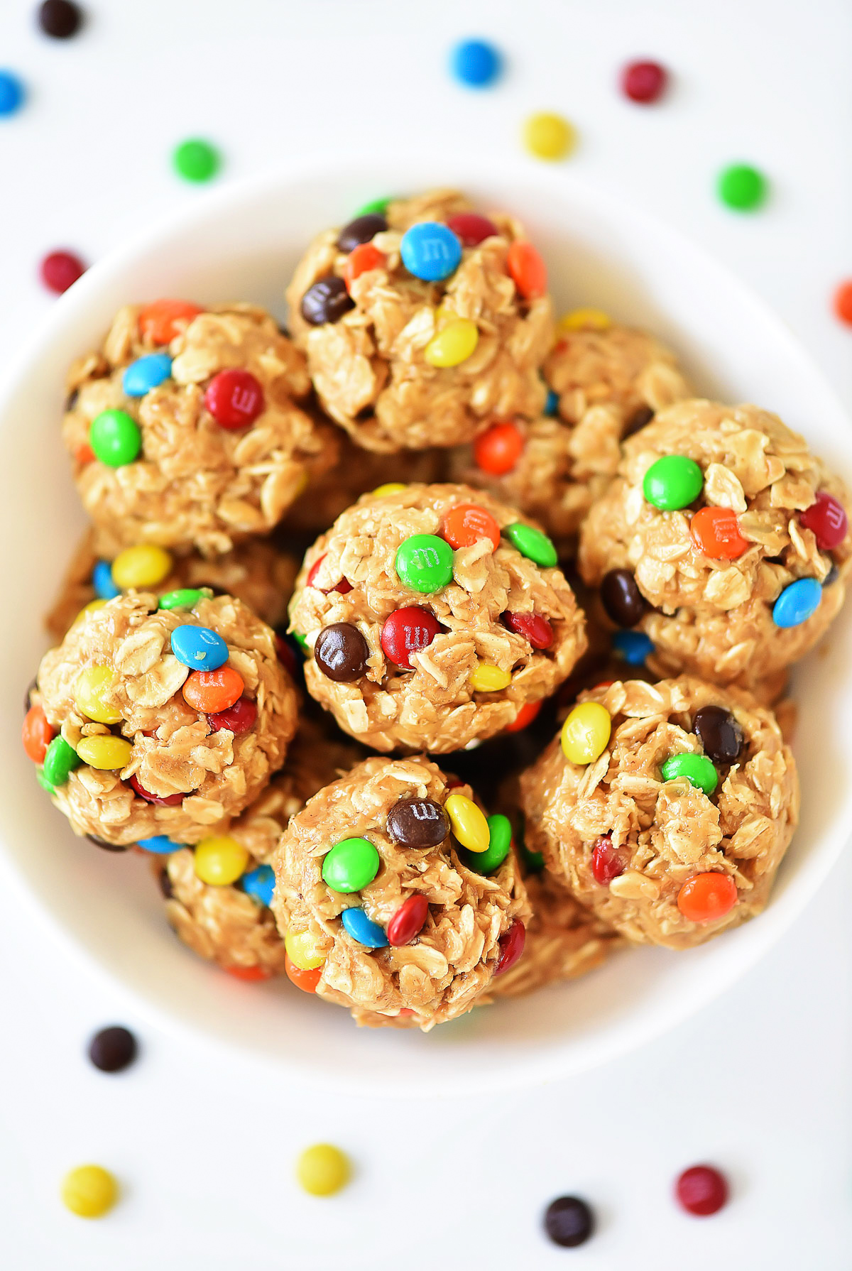 No Bake M&M Energy Bites are delicious bite-sized snacks made with oats, M&M's, peanut butter, honey and vanilla extract. Life-in-the-Lofthouse.com