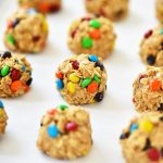 No Bake M&M Energy Bites are delicious bite-sized snacks made with quick oats, M&M's, peanut butter, honey and vanilla extract. Life-in-the-Lofthouse.com