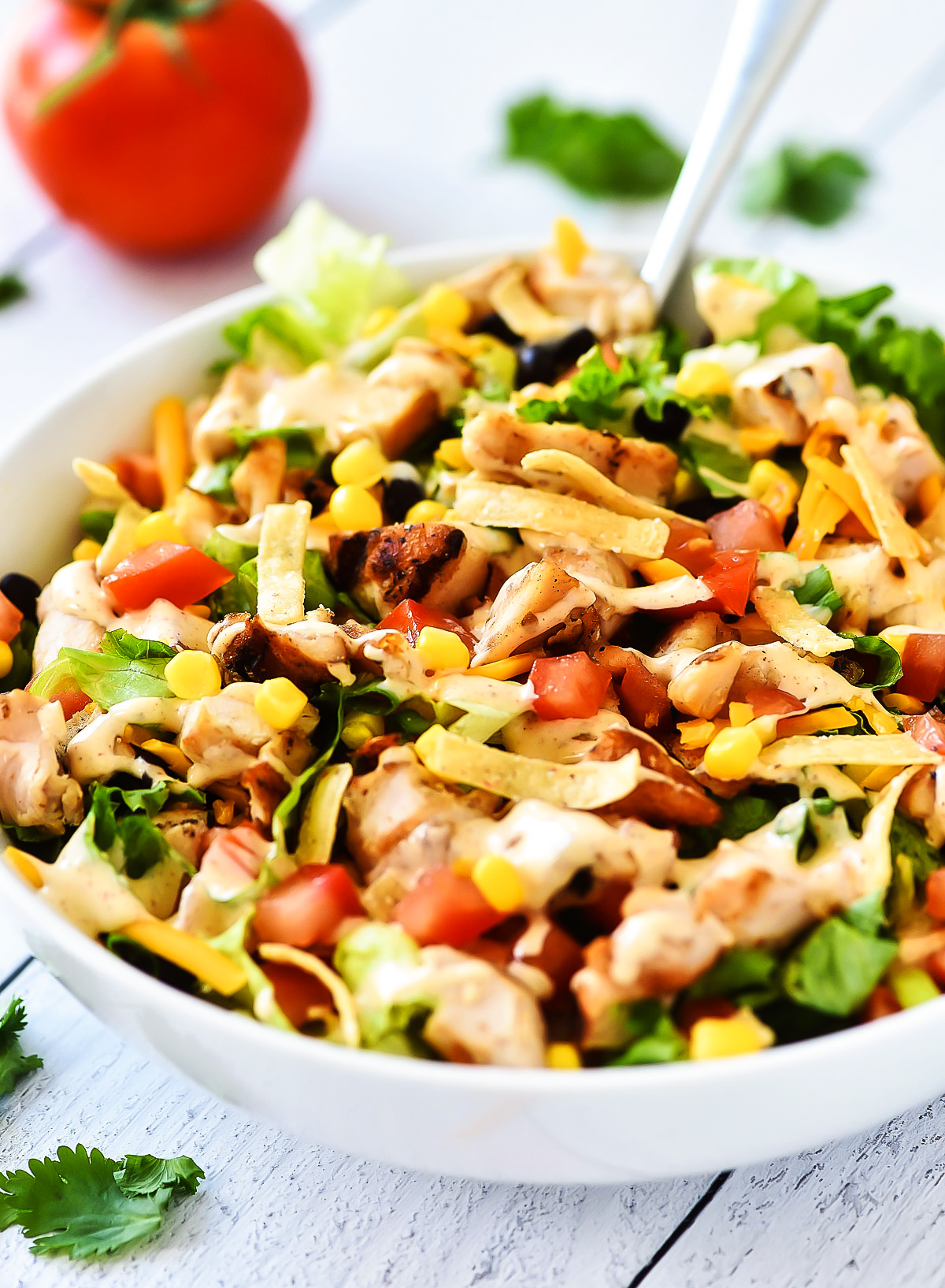 ex-Mex Chicken Chopped Salad is filled with crunchy romaine lettuce, corn, black beans, grilled chicken and more.