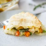 Chicken Pot Pie is a delicious savory pie filled with a chicken and vegetable filling inside a flaky pie crust. Life-in-the-Lofthouse.com