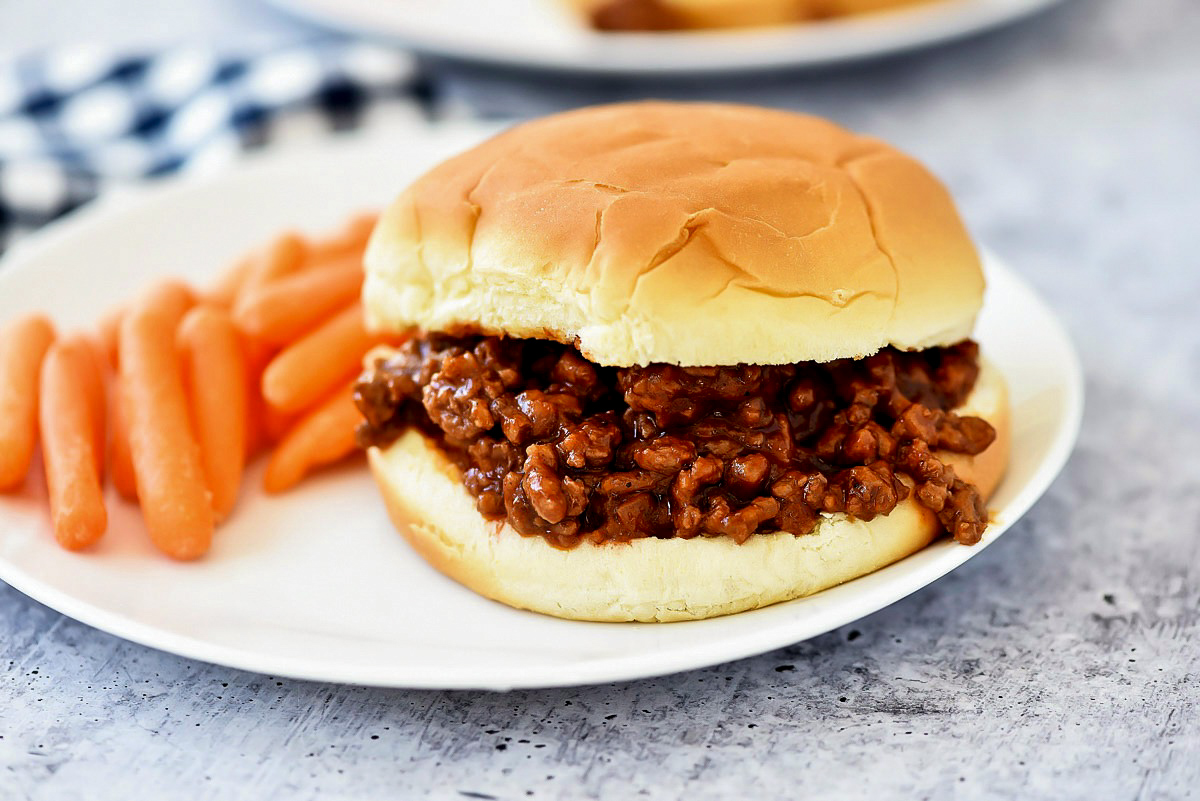 Sloppy Joes start with a homemade beef mixture that is packed with flavor and stuffed between a hamburger bun. Life-in-the-Lofthouse.com