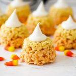Candy Corn Rice Krispie Cupcakes are rice krispie treats colored and shaped just like a candy corn. Life-in-the-Lofthouse.com