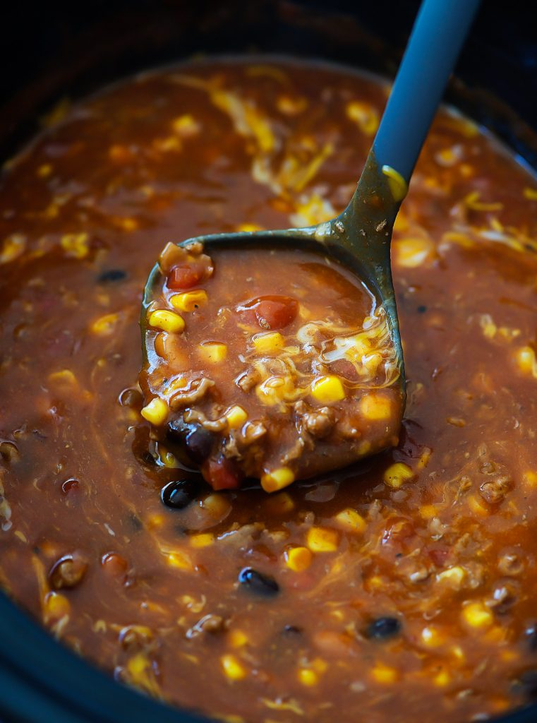 Crock Pot Taco Soup is full of delicious beans, corn, ground beef and wonderful taco seasoning. Life-in-the-Lofthouse.com