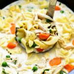 Chicken Noodle Soup is a creamy soup full of carrots, peas, chicken and noodles and all cooked in the Slow Cooker. Life-in-the-Lofthouse.com
