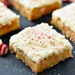 Delicious, soft sugar cookie bars filled and topped with candy cane Hershey kisses. Life-in-the-Lofthouse.com