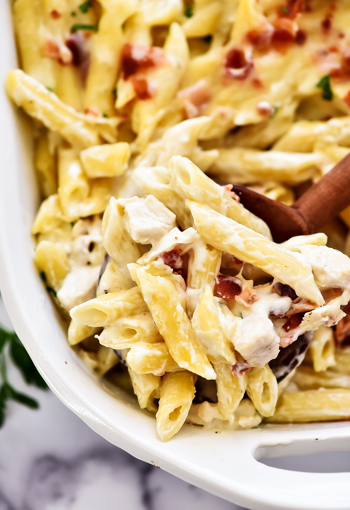 Chicken Bacon Ranch Baked Penne is filled with penne pasta, cheese, homemade Alfredo sauce, chicken bacon and ranch dressing. Life-in-the-Lofthouse.com