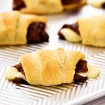 French Dip Crescents are savory little beef sandwiches filled with roast beef and cheese inside golden crescent rolls.