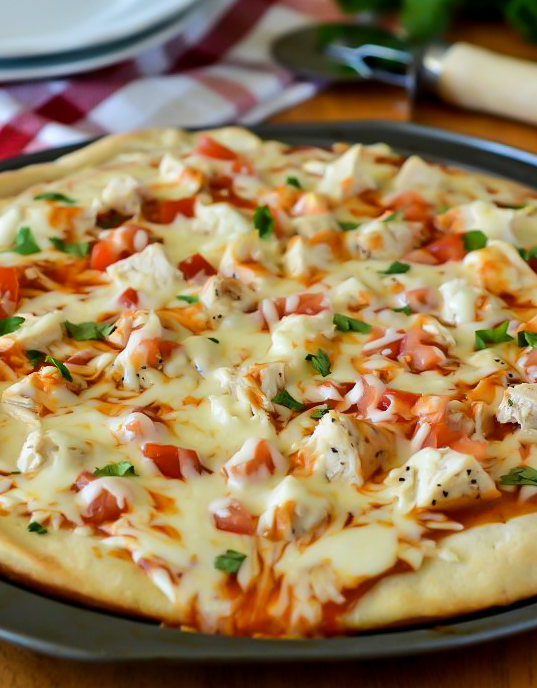 Creamy mild enchilada sauce, grilled chicken, loads of mozzarella cheese and diced tomato and cilantro make up this delicious chicken enchilada pizza. Life-in-the-Lofthouse.com
