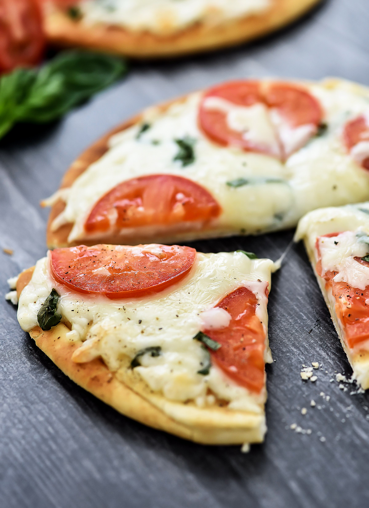 Margherita Flatbread Pizza is topped with Mozzarella and Parmesan cheese, sliced tomatoes and fresh basil over a flatbread crust. Life-in-the-Lofthouse.com