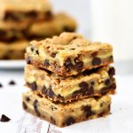 Layers of chocolate chip cookie and cheesecake are what is inside these Cheesecake Chocolate Chip Cookie Bars.