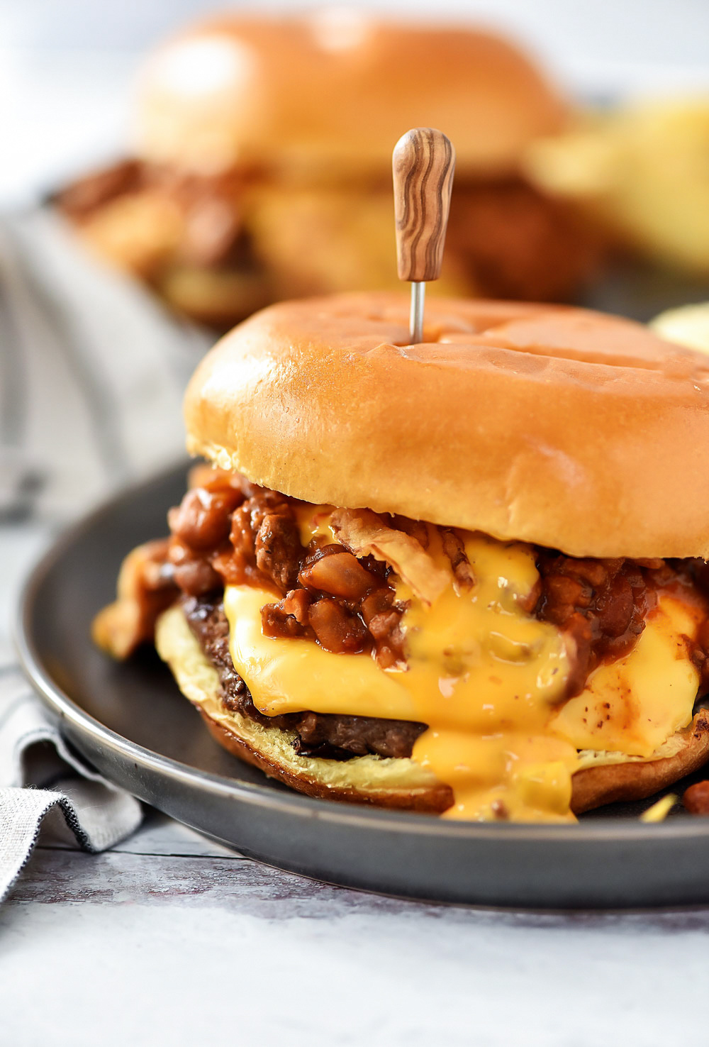Cheeseburgers topped with warm chili, melty cheese and crispy onion strings. Life-in-the-Lofthouse.com