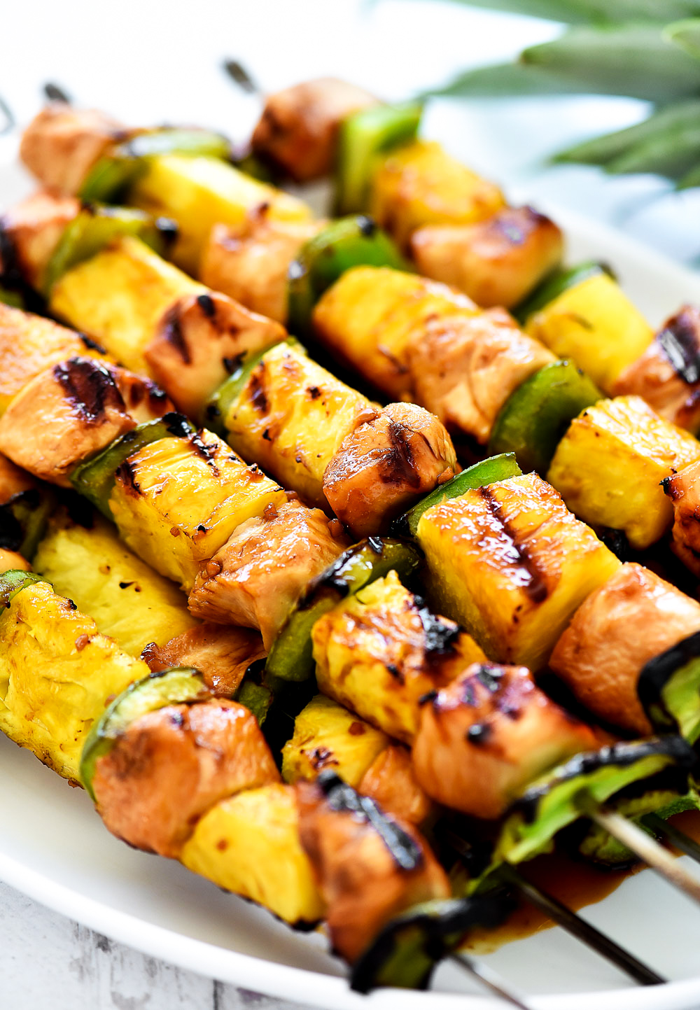 Teriyaki Chicken Kebabs are marinated pieces of chicken, with pineapple and bell pepper threaded onto skewers then grilled.
