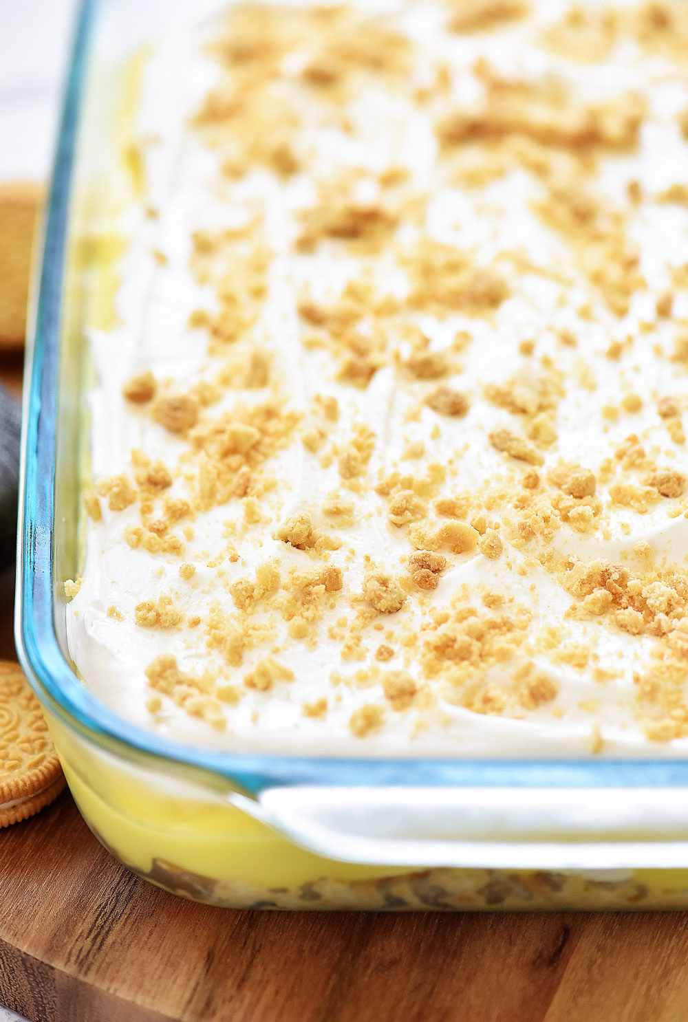 Heavenly Lemon Oreo Dessert has layers of golden oreo cookies, cream cheese, and lemon pudding. Life-in-the-Lofthouse.com