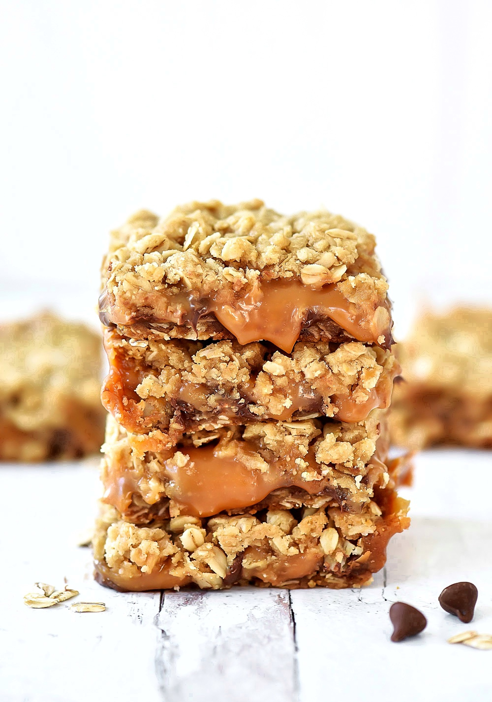 Oatmeal Carmelitas are layered cookie bars with an oatmeal and brown sugar crust and gooey caramel and chocolate filling!