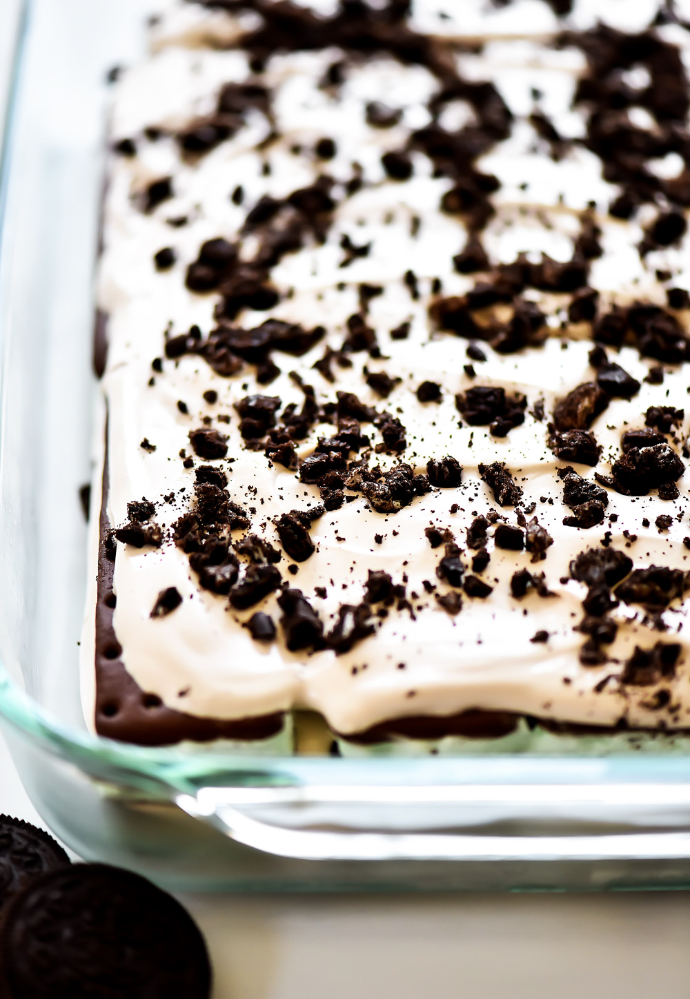 Layers of mint chocolate ice cream sandwiches, Cool Whip, and crushed Oreo cookie create one incredible dessert.
