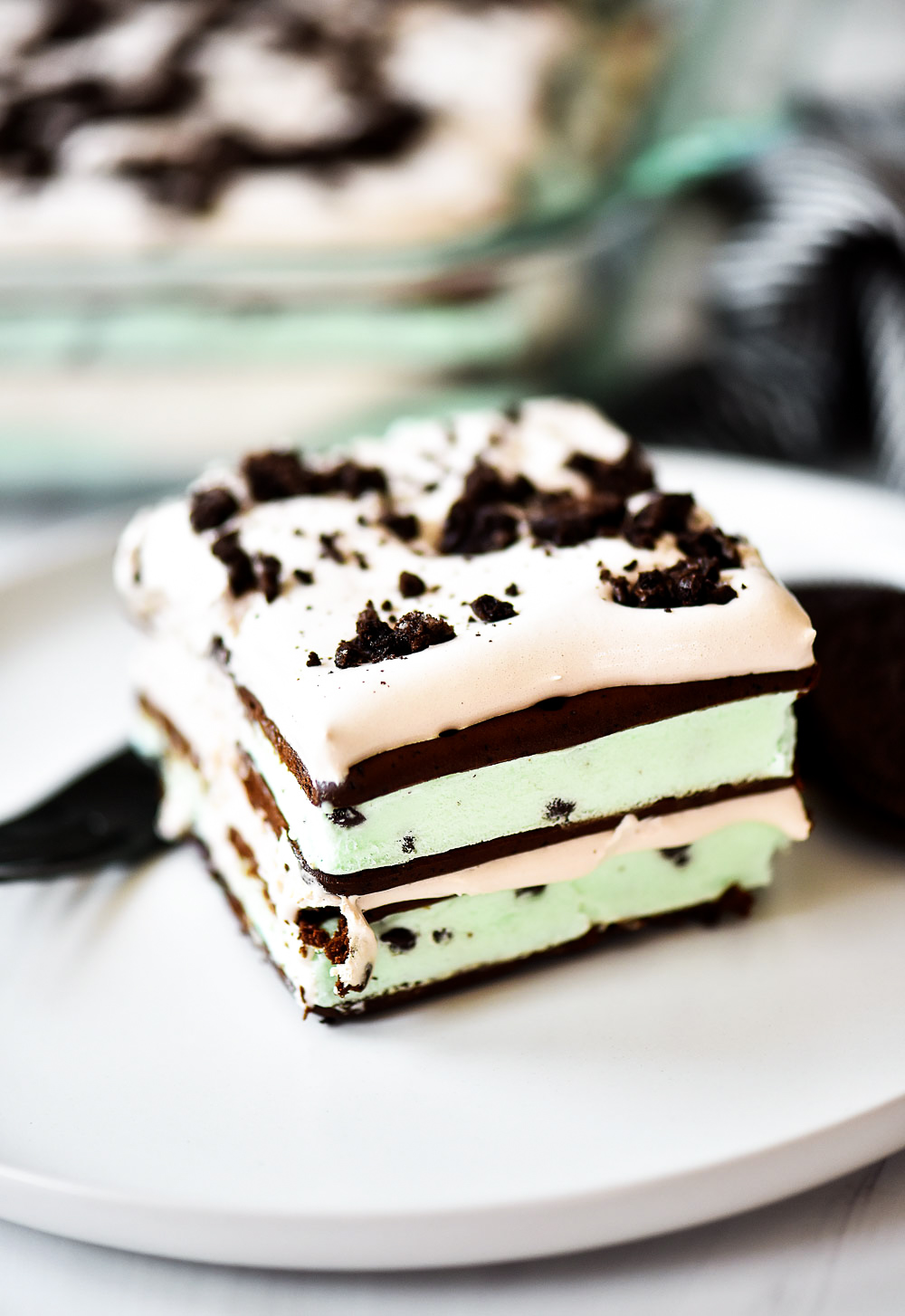 Layers of mint ice cream sandwiches, cool whip and crushed Oreo cookies create this delicious cake.