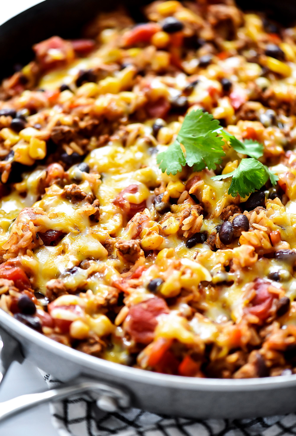 Beef Burrito Skillet is loaded with lean ground beef, jasmine rice, beans, cheese and more. Life-in-the-Lofthouse.com