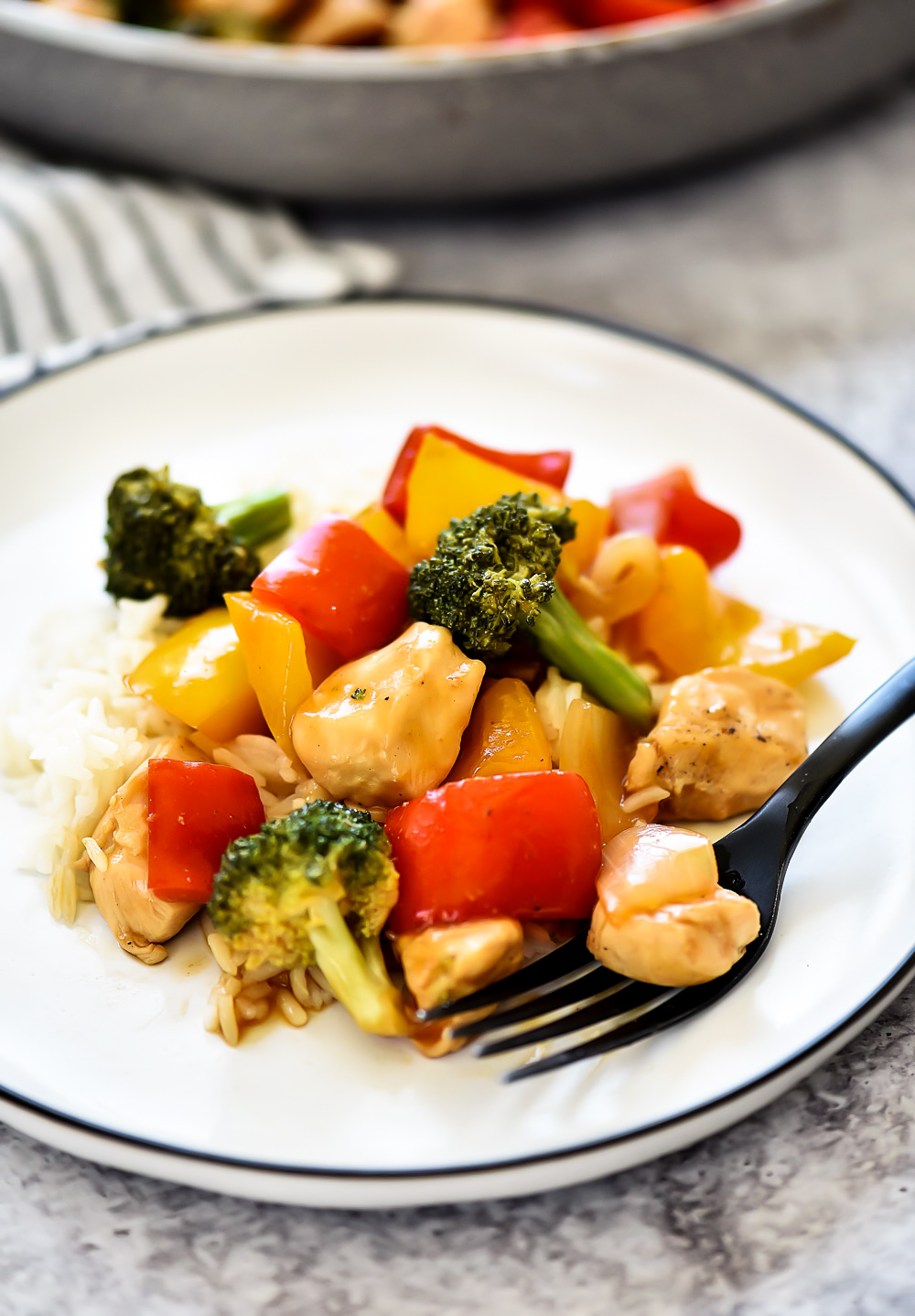 Chicken Stir Fry is seasoned chicken, red bell peppers, and onion served over a bed of brown rice. Life-in-the-Lofthouse.com