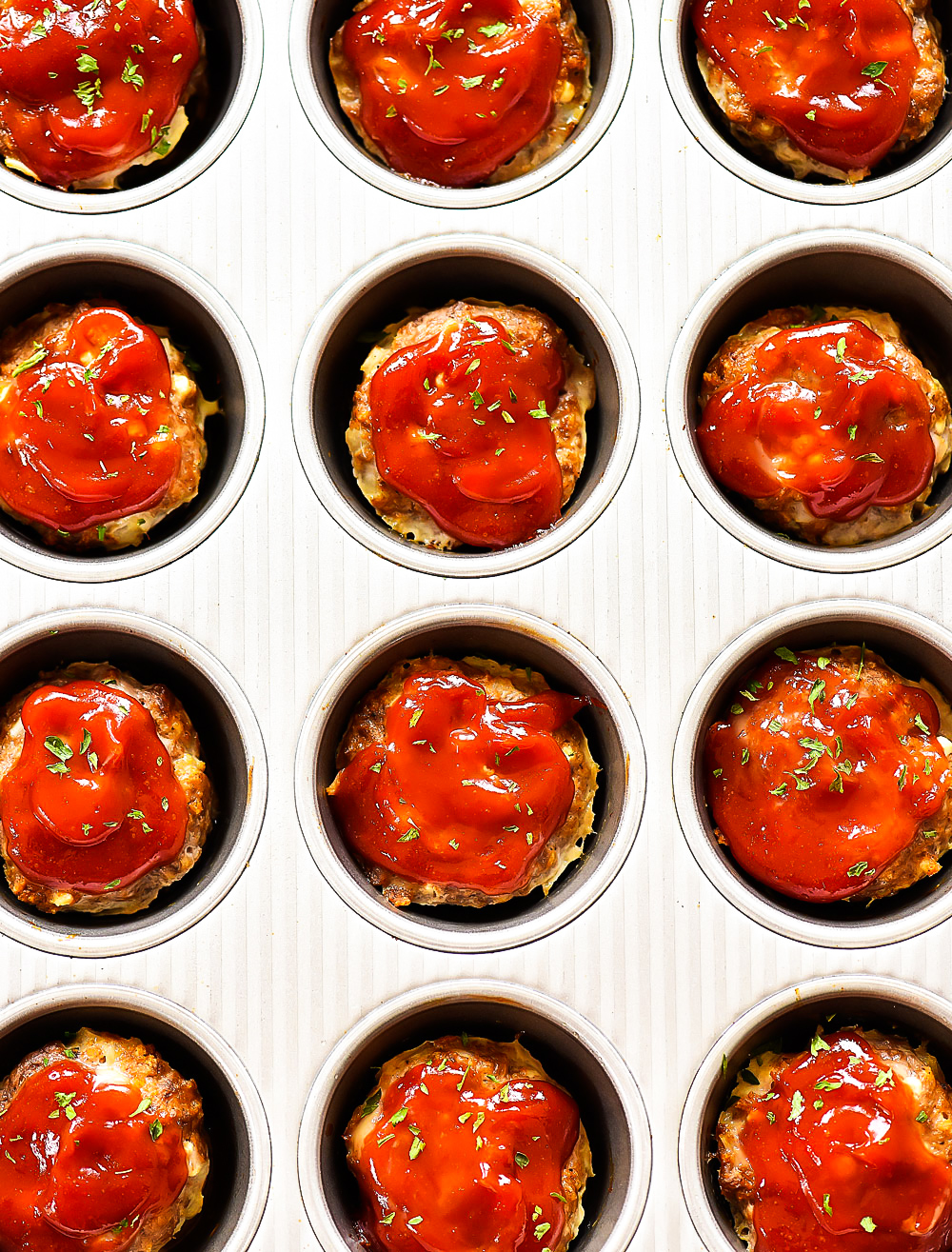 Mini Meatloaf Cups made with ground beef, cottage cheese, breadcrumbs and more. Topped with ketchup.